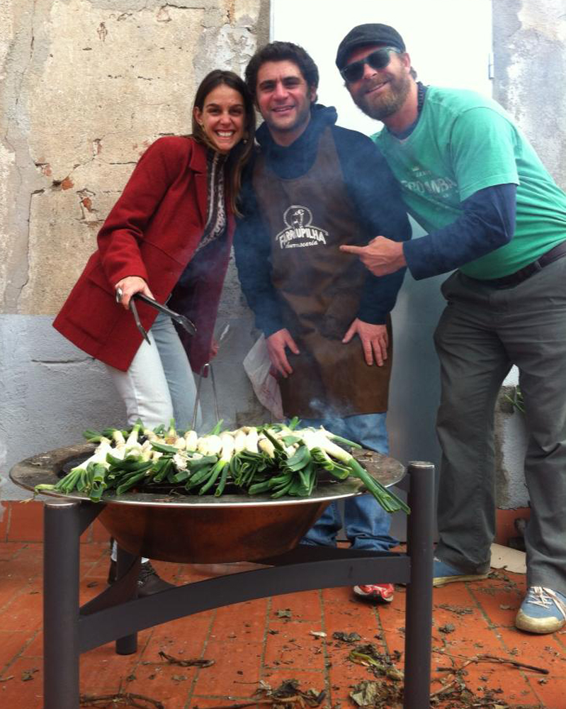 Fernanda, Lee and Brian working the barbecue at our Barcelona rooftop Calçotada