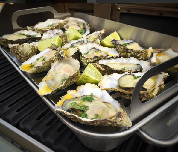Steamed oysters for a Barcelona barbecue catering event